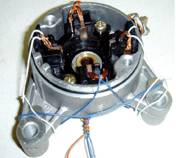 Escovas e mola do motor de partida