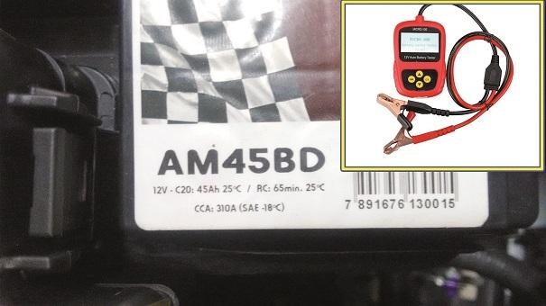 Figura 9- Bateria defeituosa e testador digital de bateria.