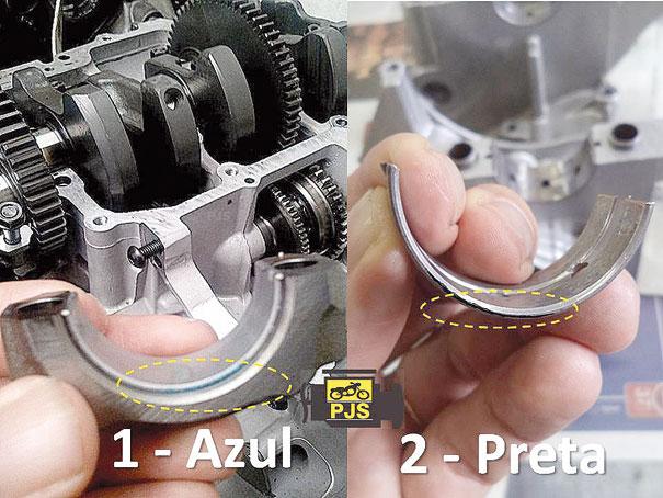 Comparativo de cores das bronzinas: 1. Bronzina da biela, cor azul; 2. Bronzina da carcaça do motor, cor preta